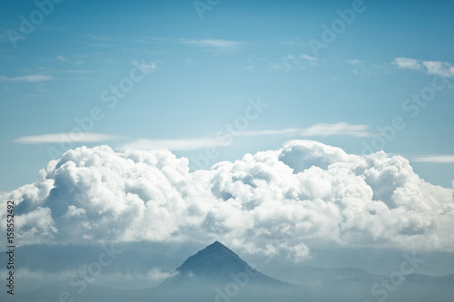 The top of the mountain among the clouds. Poster
