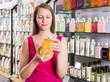 Woman take a choise shampoo