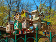 Colorful birdhouses handmade with a painting in the park in the spring.