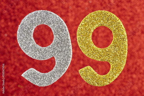 Number ninety-nine silver yellow color over a red background Poster