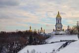 winter landscape with the Kiev-Pechersk Lavra and cloudy sky. Ukrainian sights