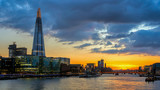 Business district with famous skyscrapers and landmarks at golden hour, London, UK