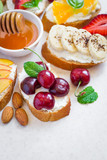 Selection of summer Colorful natural healthy snacks. Sandwiches with honey, fruit, berries. Selective focus