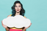 Fototapety Beautiful woman holding empty blank form in the form of clouds.