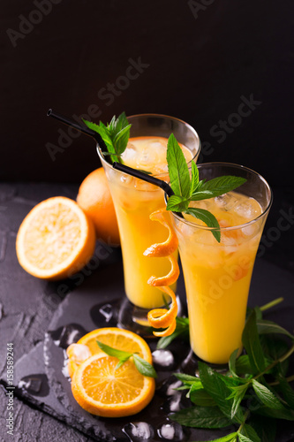 Plakat Aperitif with vodka, orange juice and mint. Screwdriver cocktail