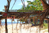 "Travel to island Koh Lanta, Thailand. Inscriptions ""Love yourself"", ""Love peace harmony"" on the wooden abandoned hut."