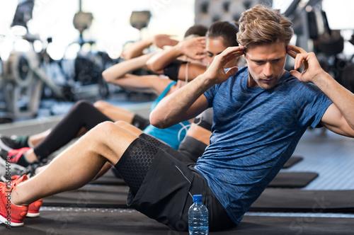 Plexiglas Fitness Man doing sit ups