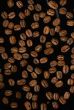 Black background. Coffee beans