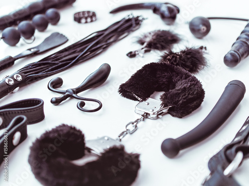Different sex toys on a light background - 158636839