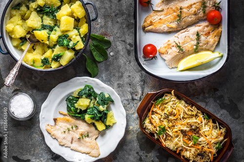 Griled fish fillet with potato and salad - 158643640
