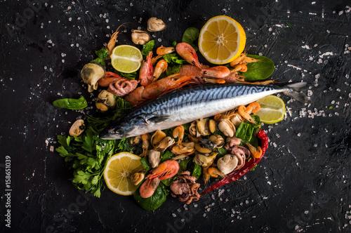 Fototapeta Seafood on a dark background