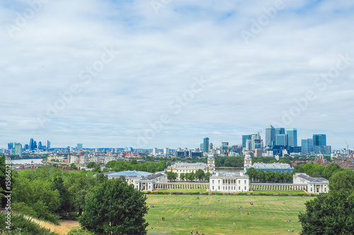 View of Old Royal Naval College building, a World Heritage Site in Greenwich, London, and skyscrapers of Canary Wharf in the distance seen from the Greenwich hill Poster
