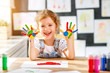 Quadro funny child girl draws laughing shows hands dirty with paint