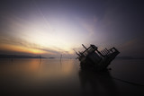 Sinking boat during sunrise