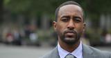 Black business man in city park face portrait serious - 158685475