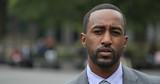 Black business man in city park face portrait serious - 158685476
