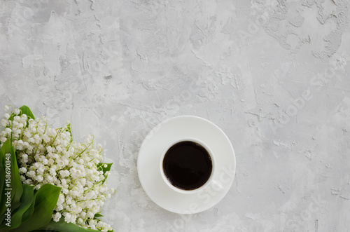 Aluminium Lelietjes van dalen Lily of the valley bouquet and cup of black coffee on a concrete texture