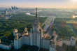 Moscow state university and Moscow city business center at sunrise. City in fog. Russia. Aerial View.