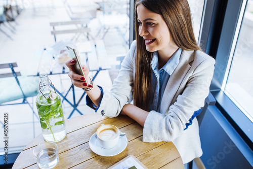 Poster Beautiful Young Woman Having Coffee