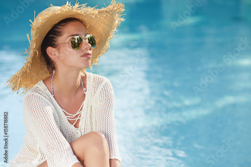 Sexy Girl With Healthy Skin In Elegant Striped Bikini, Sun Hat Relaxing In Swimming Pool Water In Resort Spa Hotel On Travel Holidays Vacation.