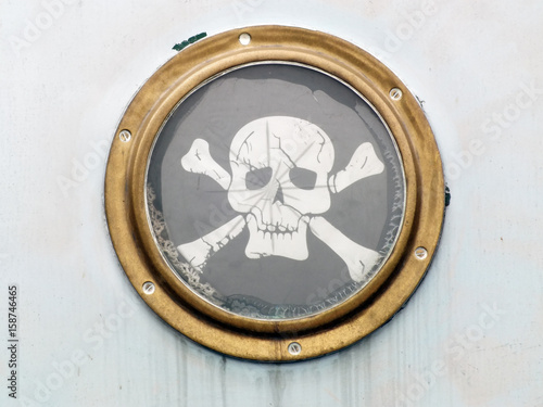brass porthole on ship with pirate flag Poster
