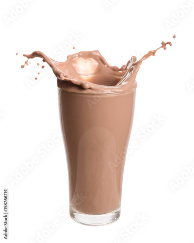 Canvas Milkshake Chocolate milk splash out of glass., Isolated on white background.