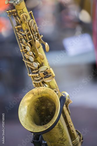 a saxophone sitting on a stage at a concert Poster