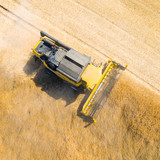 Aerial view of combine harvester. Harvest of rapeseed field. Industrial background on agricultural theme. Biofuel production from above. Agriculture and environment in European Union. - 158793066