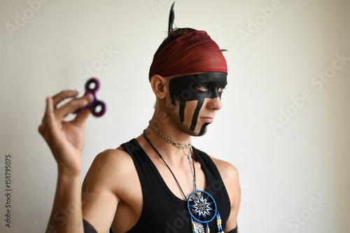 man holding popular fidget spinner toy  Poster