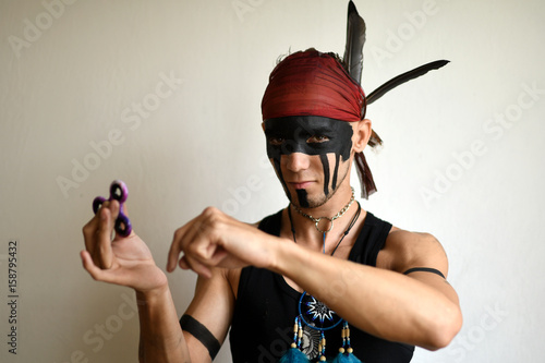 man holding popular fidget spinner toy