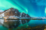 green northern light explosion over a fjord