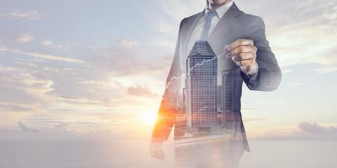 Businessman against modern city background