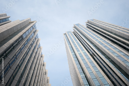 upward view of modern building Poster