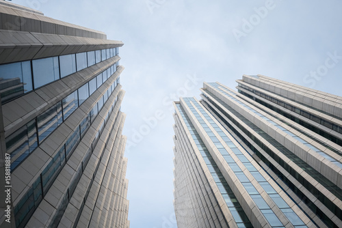 upward view of modern building Poster