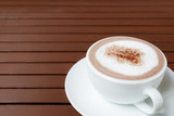 cup of hot chocolate with copy space on wooden table background