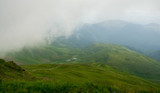 Landscape of the Carpathian Mountains with fog