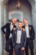 Joyful groom and his funny friends