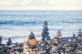 Concept of harmony and balance. Balance stones opposite the Atlantic ocean waves. Rock zen in the form of scales. Many balancing pebbles Stones Stacks. Canary islands, Tenerife, Adeje, Playa Del Duque