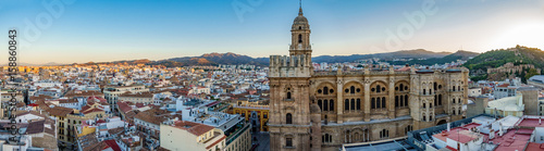 Cityscape of Malaga Cathedral and city at dawn