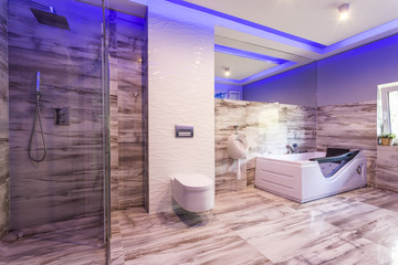 Bathroom with marble tiles and glass shower cabin