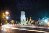 Sofia square in the center of Kiev at night with light trails from the cars and starry sky. Ukraine, Europe