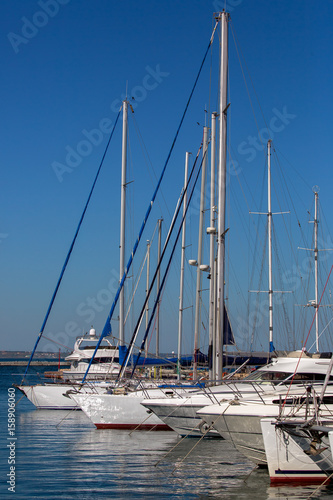 yachts moored in a marina.