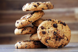 Chocolate cookies on wooden table. Chocolate chip cookies shot - 158911633