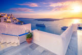 Amazing evening view of Fira, caldera, volcano of Santorini, Greece with cruise ships at sunset. Cloudy dramatic sky. - 158919222