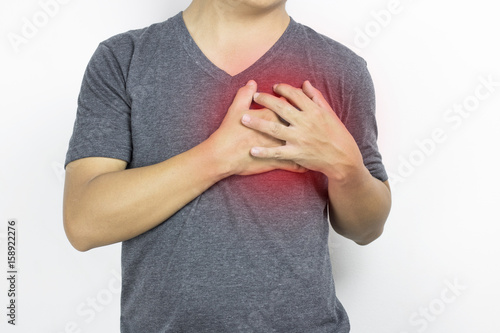 Man, guy has heartache in gray clothe and  hand touch with pain on white backgro