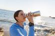 Quadro Woman drinking water on beach