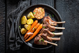 Delicious roasted lamb ribs with thyme on dark background - 158939607