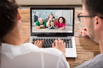 Couple Chatting With Family On Laptop