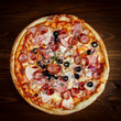 Delicious homemade pizza with mozzarella, ham, olives and fennel. - 158953829