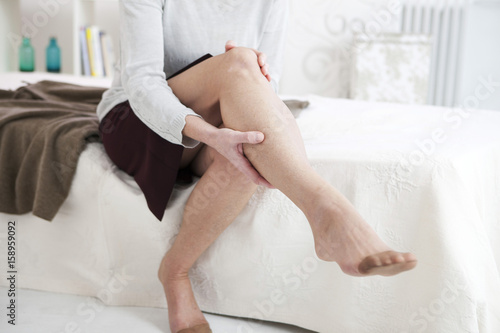Senior woman suffering from leg pain